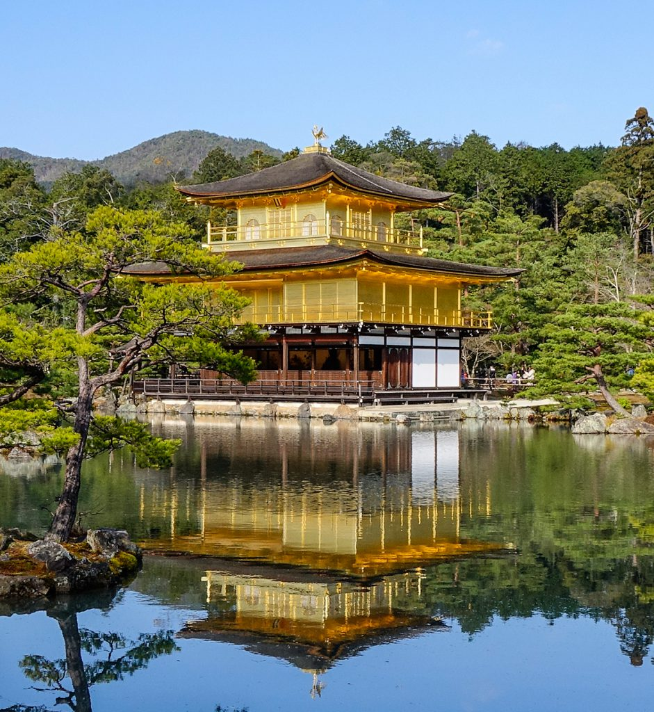 A picture of Kyoto's famous Kinkakuji.  This temple pagoda is covered in real gold.