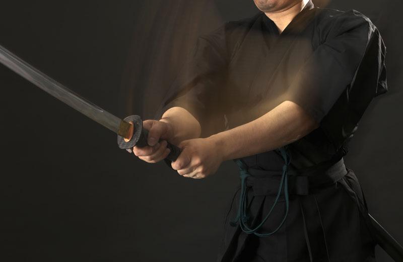 Image of slashing Iaito sword