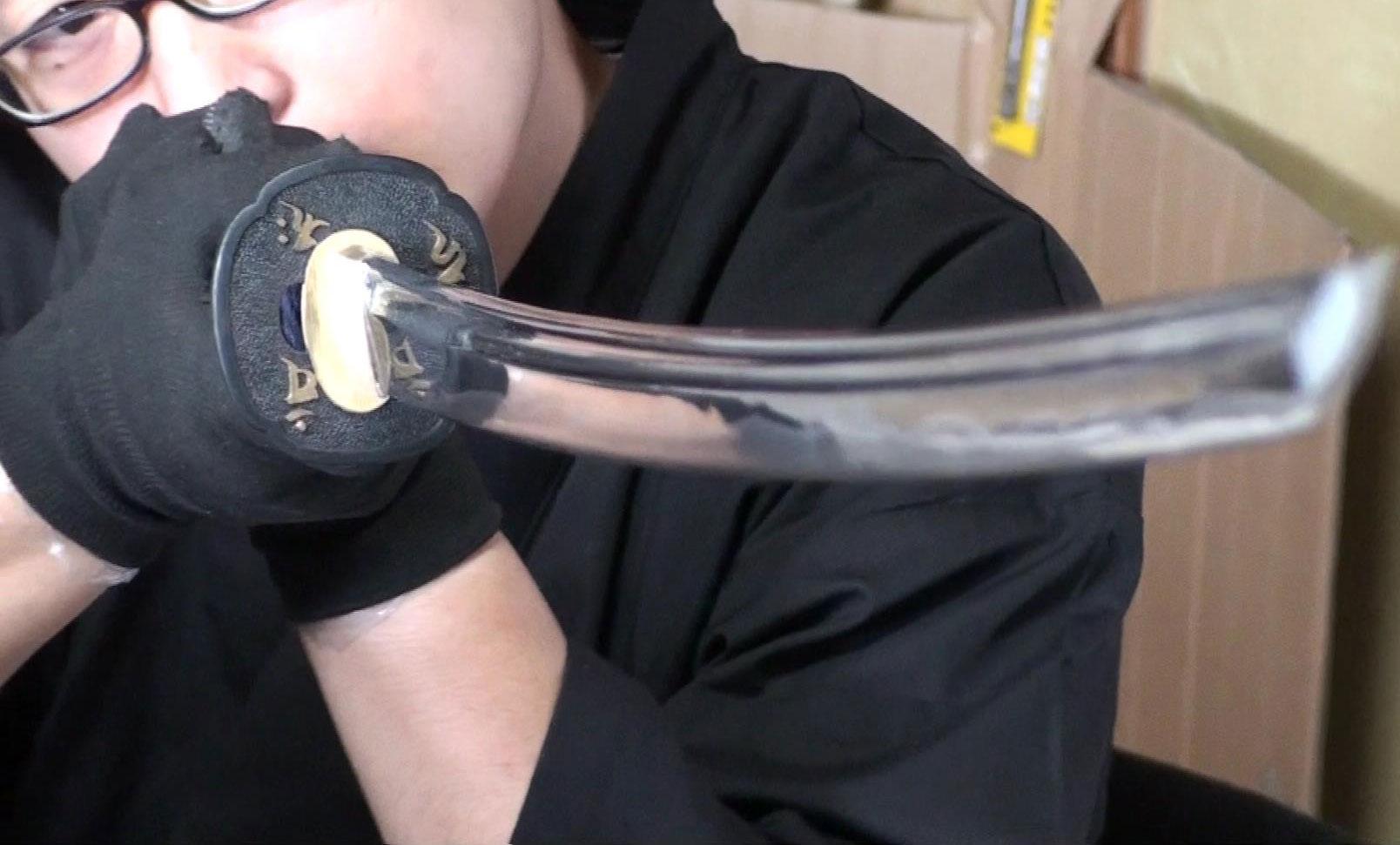 Tozando's sword craftsman inspecting Suzaku Iaito