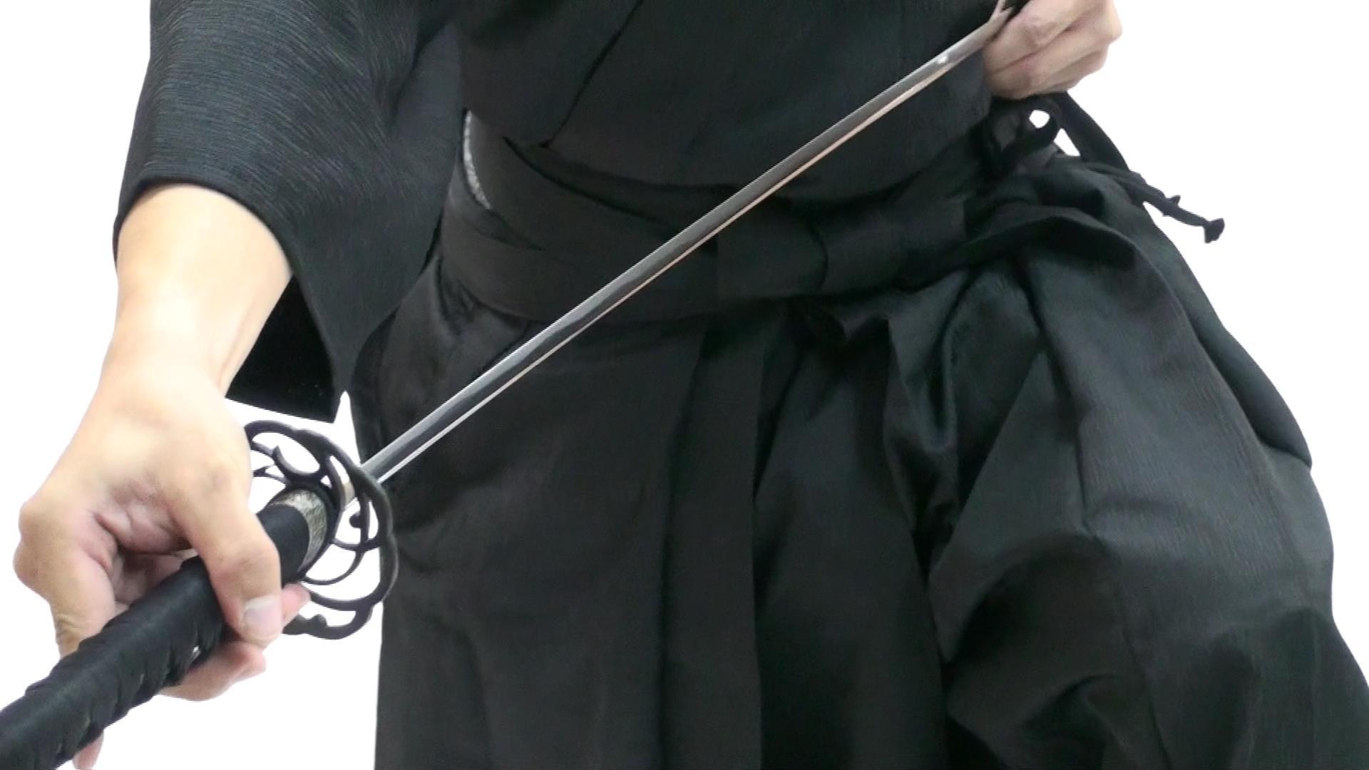 Sheathing Iaito sword.