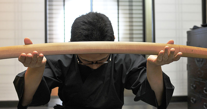 Image of bowing to Japanese sword