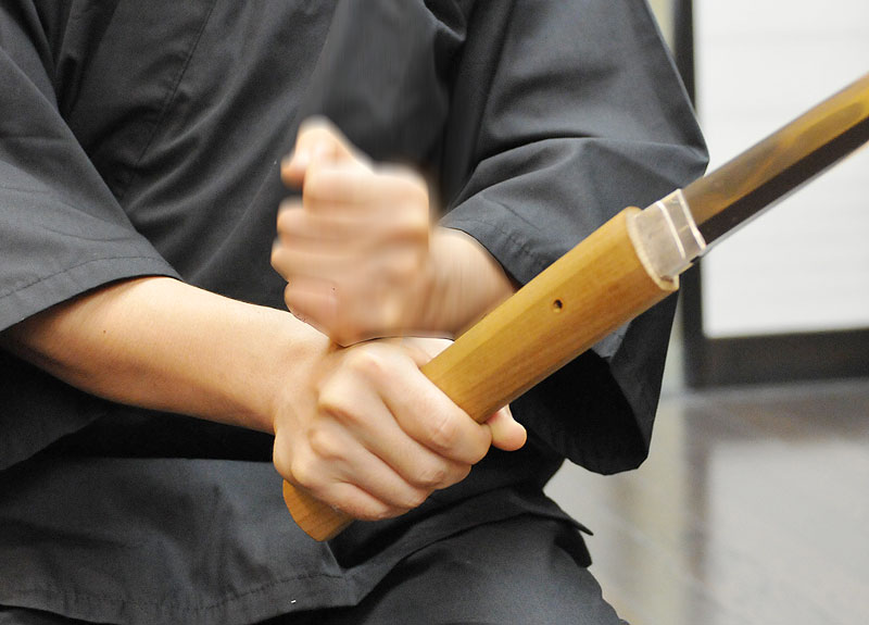 Image of right fist hitting your left wrist lightly a few times to remove the blade from Tsuka