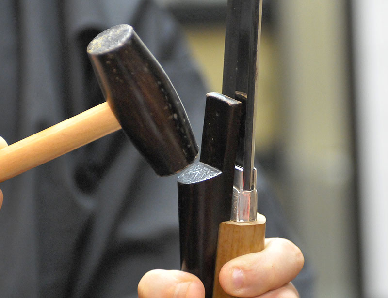 Using a mallet to remove Japanese sword blade from Tsuka