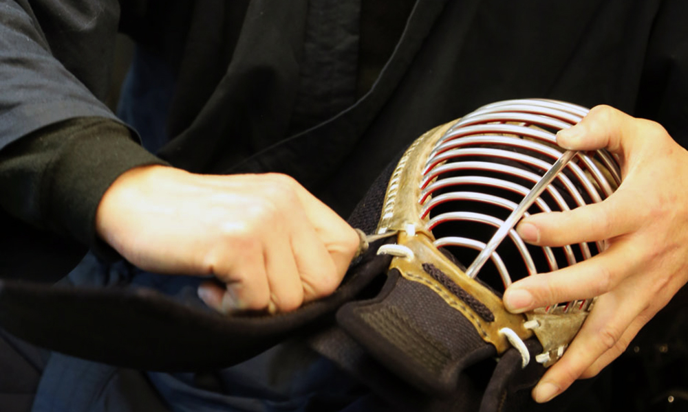 An image of Tozando Kendo craftsman assembling Men mask