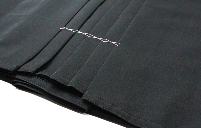 Tozando Deluxe Polyester Aikido Hakama AH500's hem featuring edge stitching and Aikido cut