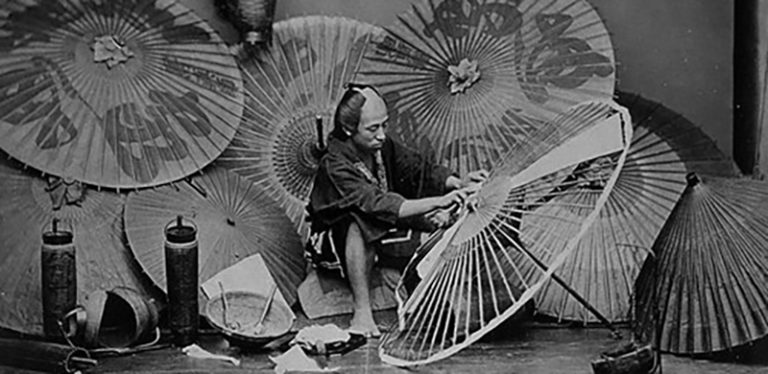 A lower ranked Samurai doing his part time job of making an umbrella