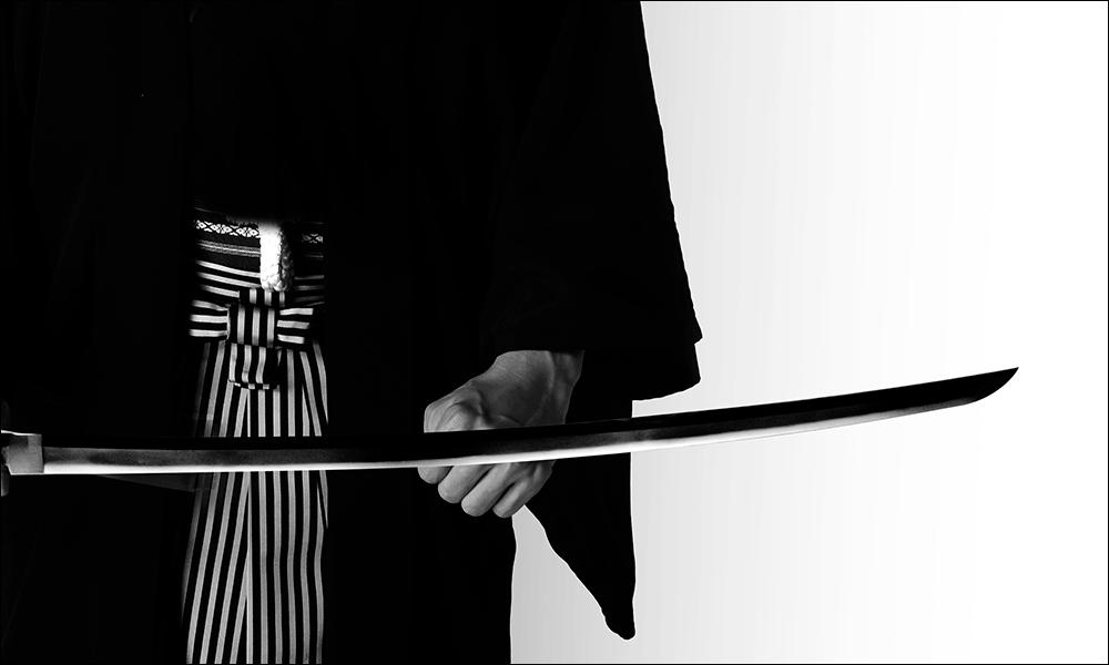 Samurai holding a naked Japanese sword Katana blade