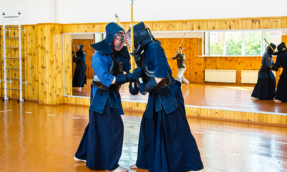 Middle-aged Kendo players doing Keiko training