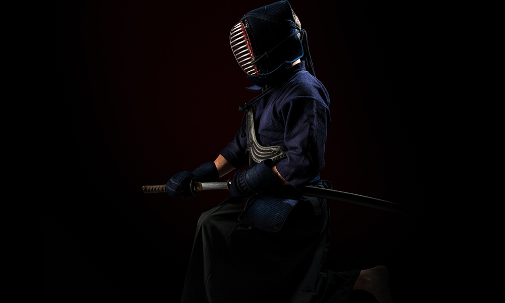 Image of Kendo player drawing Japanese sword