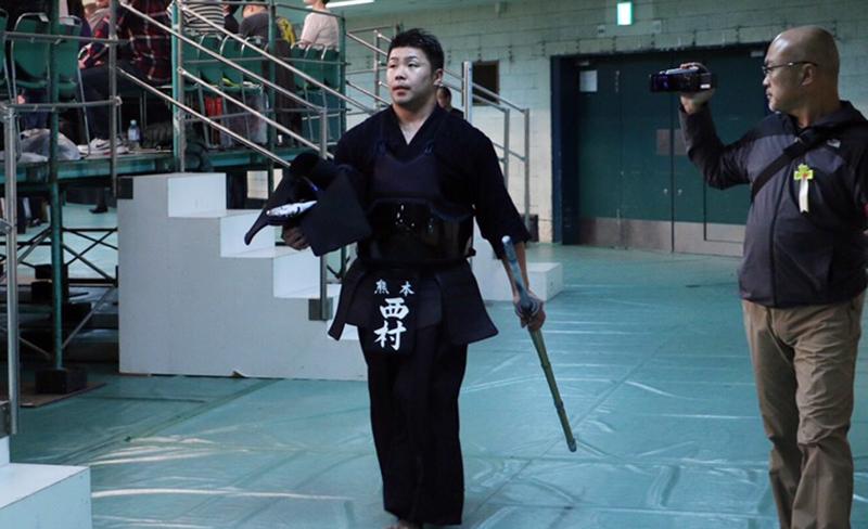 Nishimura walking to the arena