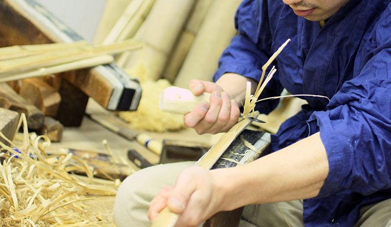 Kendo Shinai craftsman, Akutsu shaving the edge of bamboo stave