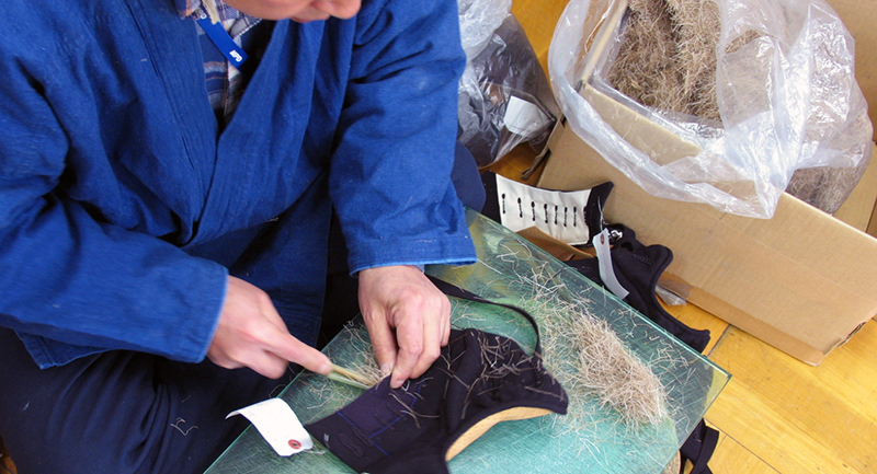 Kendo Bogu craftsman putting deer fur into Kote glove