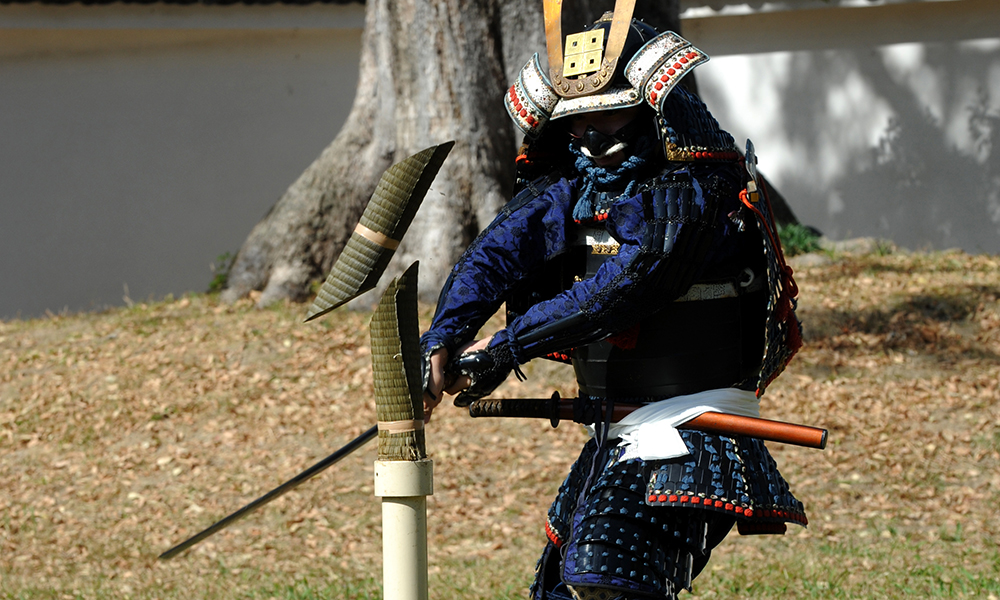 Samurai warrior cutting a roll of Tatami(Batto)