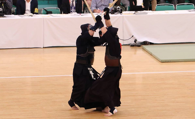Katsumi sword-battling against his opponent at the 66th All Japan Kendo Championship Taikai
