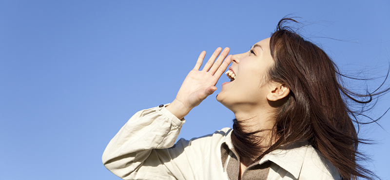 A picture of Japanese lady shouting to the sky