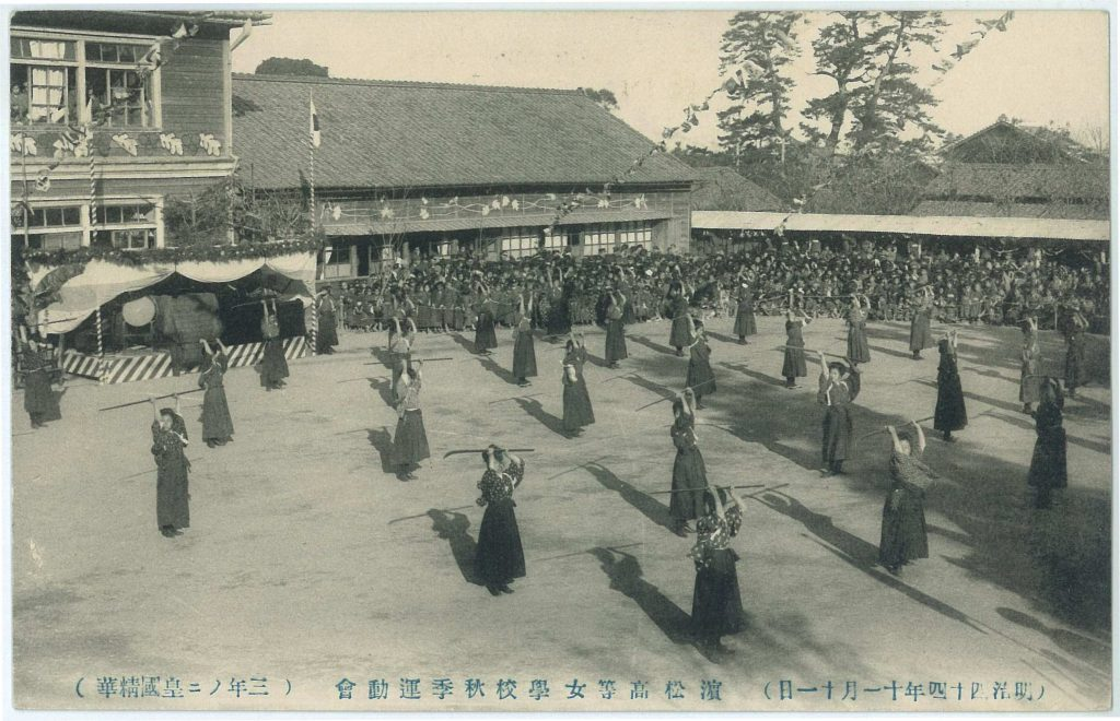 Meiji high-school girls practicing naginata drills at their sports day.
