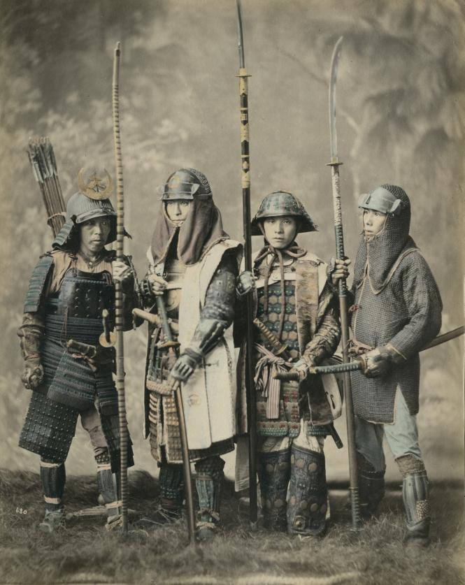 Soldiers wearing the armour of the samurai and holding naginata.