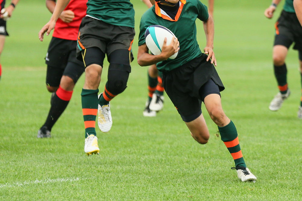 A running rugby player