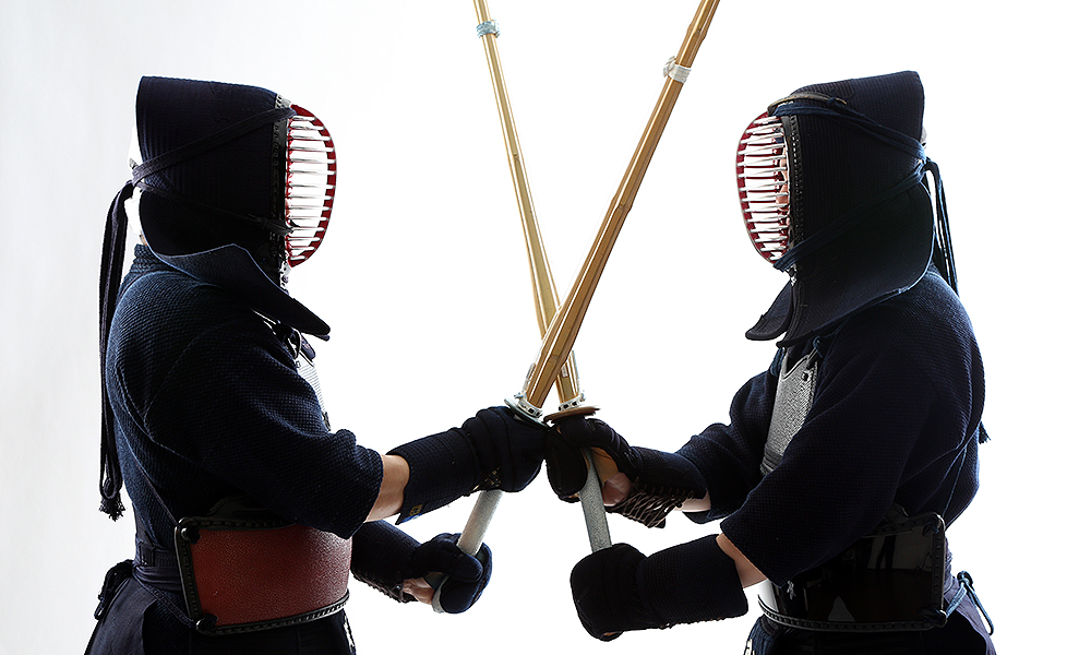 Two Kendo players facing each other