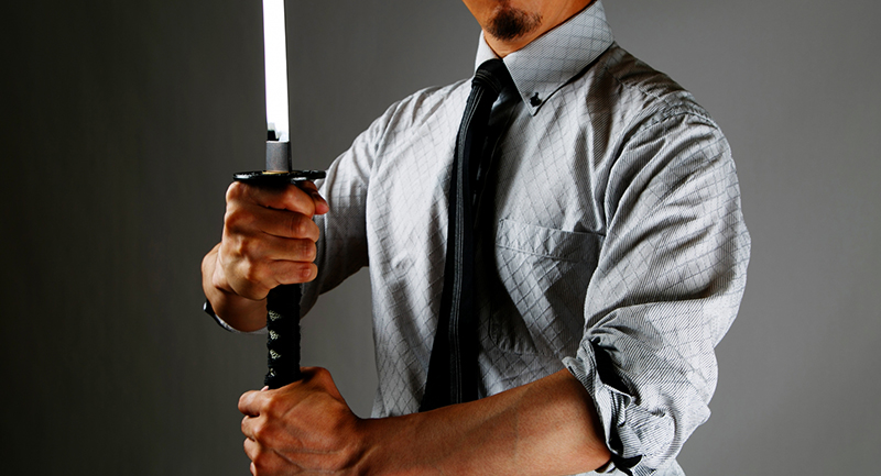 A business man with Japanese sword
